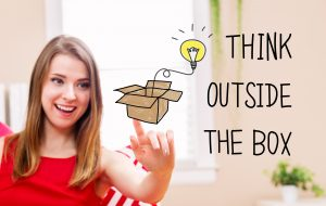 Think Outside The Box concept with young woman