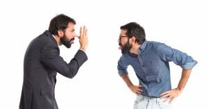 Twin brothers making a joke over white background