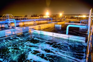 Modern wastewater treatment plant of chemical factory at night.