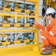 Electrical and instrument site service temperature transmitter on offshore oil and gas wellhead platform to monitor and record gas and oil temp inside flow line pipe, Electrician job. Bild: Pichitstocker - Adobestock