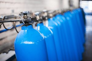 Oxygen cylinder with compressed gas. Blue Oxygen tanks for industry. Liquefied oxygen production. Factory