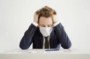 Stressed Businessman in Face Mask. Lockdown Coronavirus Concept.