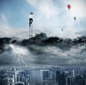Businessman on a ladder escapes from crisis and looking for a new way